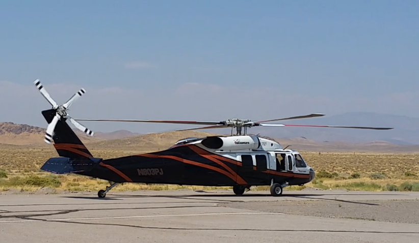 Our pop in visitor - PJ Helicopters UH-60A came through to rig up a bucket.